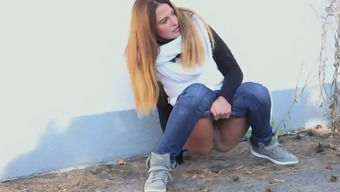 Gorgeous black young adult missy in tight denim pees in the streets
