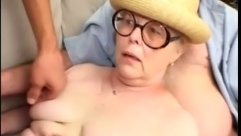 Granny along with classic round eye-glasses kissing dicks of males