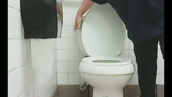 Round senior light colored lady in mordant denim pisses among the potty