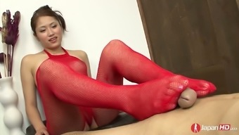 Dressed up in scarlet fishnet stuff Japanese Iori Miduki gives footjob to really her man