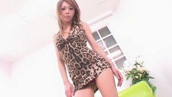 From asia female within the very short gown savours showing her human body