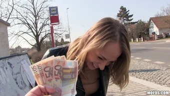Euro cutie can take the cash and truly gives a cock drive upon the grassland