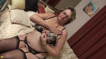 Perverted bespectacled granny has some fun with her favorite sexual intercourse replica toy