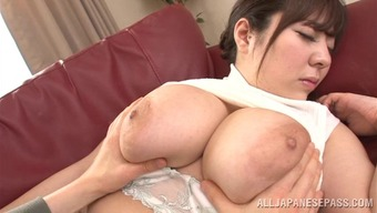wonderful oriental milf with big titties delivering a sultry handjob