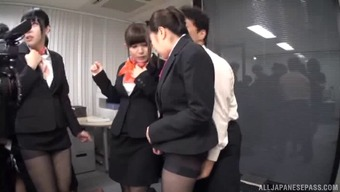 Suit-wearing Japanese girls getting a huge penetration orgy