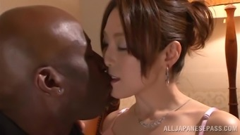 Japanese hussy gets her pussy touched and torn up by the black hunk