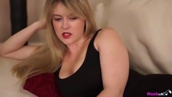 Ideal light haired by yourself MILF is busy by using teasing herself on sofa