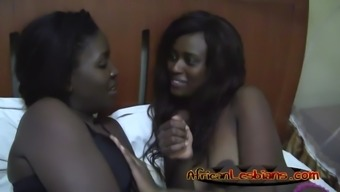 Two slutty amateur ebony chicks thrash one another vaginas in become 69