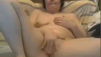 Lustful and wild granny touching her vaginal canal in guitar solo video