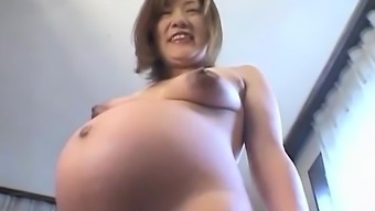 From asia preggo plays with the titties