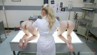 Perverted nurse is fucking slutty anal hole of Audrey Christmas and her scarlet haired girl friend