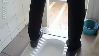 White colored novice hen in black underwear pissing among the toilet