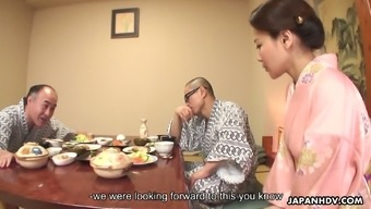 After a festive dinner lusty Japanese housewife works on two dicks