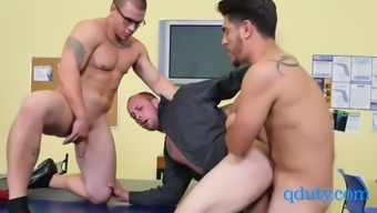 Gay coworking mates engage in hot threesome in the office