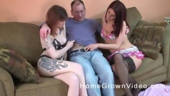 Two tattooed busty MILF babes share a cock in a threesome