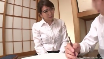Nerdy Japanese brunette MILF Ono Sachiko gives a tit job