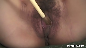 Lewd stud tickles adorable Japanese hottie Yuria Tominaga's pussy utilizing a just brush