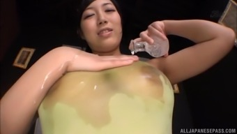 Oiled hottie Sakura Nene appreciates a solid pecker a little over anything