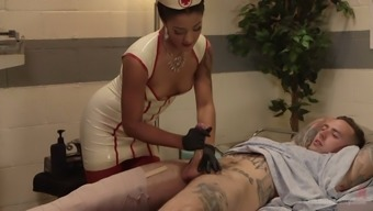 Busty black nurse Daisy Ducati inspections dude's prostate and wanks his lift