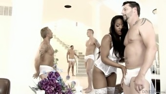 Charming black babe in white lingerie Monique Symone is fucked by several studs