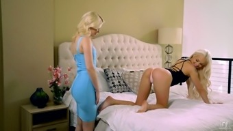 Glamorous blond babe Charlotte Stokely is pleasing tasty looking pussy of sizzling GF