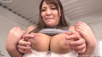 Busty Japanese Housaki Yua lets a guy strip her and play with her tits