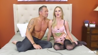 Tattooed blonde MILF Jenna Jones rides a hard cock in stockings