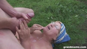 Mature country granny takes cum on her face outdoors