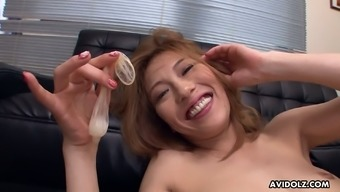Fun loving sex crazed vixen Sally Yoshino loves that cum filled condom