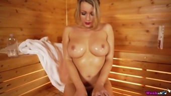 Torrid depraved alone Penny L teases her wet pussy in the sauna