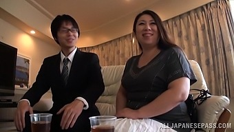 Chubby Japanese amateur undressed and fucked by a guy with glasses