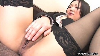 Asian cougar in stockings Ai Mizushima is playing with puffy hairy pussy