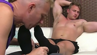 Naughty gay guy likes it when a kinky friend sucks on his toes