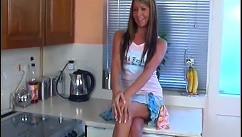 Horny girl Antonia Stokes fingering her pussy in the kitchen