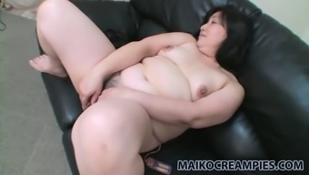 Vivacious mature woman Yoko Momose likes to address her clit with her like egg