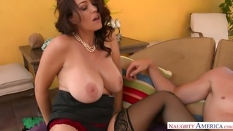 Dissolute mother Charlee Chase gives blowjob and footjob to the hot bloke