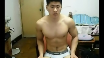 Beefy Chinese people male model lifts off his clothing and bad boys off his cock on webcam.