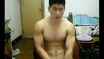 Burly Chinese chunk lifts off his outfit and jerks off his junk