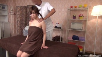 Brown-haired hen encourages the guy rubdown both her back and her pussy