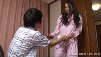 A charming Japanese housewife gives her man a handjob