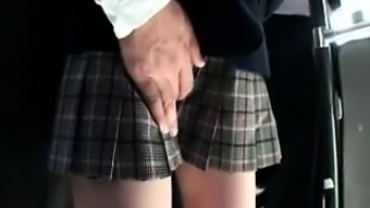 Cute From asia schoolgirl consists of a horny bloke touching her puss
