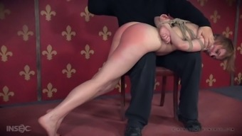 Submissive nerd Sierra Cirque gets undressed and tied up before spanking