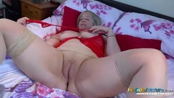 Sexy mature lady dressed in red is playing alone with her pussy